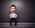 Dancing businessman with big head full length funny picture of over dark background Stock Photography