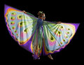 Dancing butterfly woman young dressed in a colorful costume in black back Stock Photography