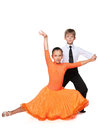 Dancing children boy and girl against the white background Royalty Free Stock Photo