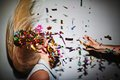 Dancing in confetti blond girl nightclub while man throwing at her Stock Photography