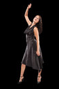 Dancing female on the black background Royalty Free Stock Photo