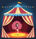 Dancing girl on circus arena. Entertaining show. Woman in burlesque corset costume with feathers. Carnival marquee
