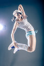 Dancing girl young woman in sport dress in zumba or reggaeton or hiphop style Royalty Free Stock Photo