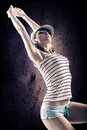 Dancing girl young woman in sport dress in zumba or reggaeton or hiphop style Royalty Free Stock Photography