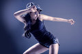 Dancing girl young woman in sport dress in zumba or reggaeton or hiphop style Stock Image