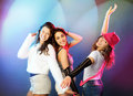 Dancing girls on illumunated background Royalty Free Stock Photography