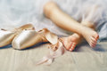 Dancing gracefully little girl trying on ballet shoes Royalty Free Stock Image