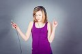 Dancing happy teenager girl listening to music Royalty Free Stock Photo