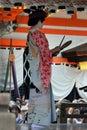 Dancing Maiko woman at Japanese Shrine, Kyoto Royalty Free Stock Photo