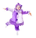 Dancing marionette adorable girl in clown costume posing as a without strings Stock Image