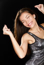 Dancing party woman in sexy dress having fun dance smiling happy on black background beautiful girl partying multiracial asian Royalty Free Stock Photos