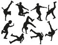 Dancing silhouettes male on white Stock Photography