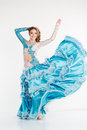 Dancing teen girl in fashion oriental dress Royalty Free Stock Photo