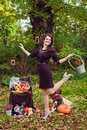 Dancing woman with a basket of flowers in autumn park Royalty Free Stock Photo