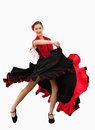 Dancing woman in a red and black dress Royalty Free Stock Photography