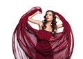 Dancing woman in red dress flying on wind Stock Photos