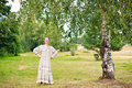 Dancing woman in the Russian national dress. Royalty Free Stock Images