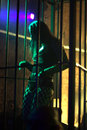 Dancing woman in a steel cage Stock Image