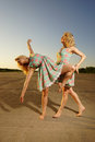 Dancing women young on the road Royalty Free Stock Image
