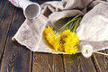 Dandelions and vase