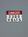 Danger 2300 volt,  text on vintage wall, Stock Photo