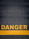 Danger asphalt road markings conceptual image of as yellow with single line and copy space Royalty Free Stock Photos