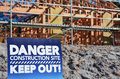 Danger building site sign in a new home construction concept photo of a new home mortgage finance economy market Royalty Free Stock Photo
