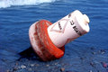 Danger buoy lake erie toppled shore Stock Image