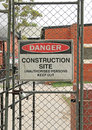 Danger, Construction Site warning sign at building site Royalty Free Stock Photo