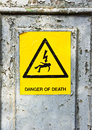 Danger of death yellow sticker on a rusty metal surface Stock Image