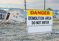 Danger demolition sign area warning people not to enter this site in the background houses that were damaged by hurricane sandy in Royalty Free Stock Photography
