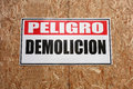 Danger demolition a sign on a wall in spanish that reads Stock Images