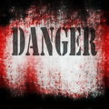 Danger on grunge bloody background and texture Royalty Free Stock Images
