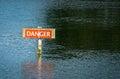 Danger Hazard Warning Sign in River Royalty Free Stock Photo