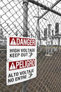 Danger high voltage keep out sign there are warning signs around electrical substations that have large connectors to handle the Stock Photos