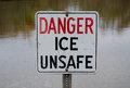 Danger ice unsafe metal sign reading Royalty Free Stock Image