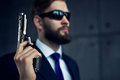 Danger man with gun agent and sunglasses focus on Royalty Free Stock Image