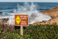 Danger Sign with Crashing Waves at Sunset Cliffs Royalty Free Stock Photo