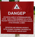 Danger sign next to runway at Gustaf III Airport at St Barts , French West Indies Royalty Free Stock Photo