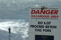 Danger sign with person in background who has obviously disregarded the message Royalty Free Stock Photo