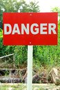 Danger signage in red background with white wording Stock Images