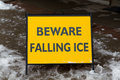 Danger watch for falling ice and snow sign a warning people to Stock Photos