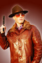 Dangerous looking mafia type with revolver. Royalty Free Stock Photography