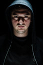 Dangerous man portrait of a with an intimidating expression Stock Photo