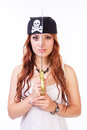 Dangerous pirate woman with copper hair holding a sword in front of her face isolated on white Stock Photos