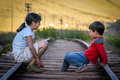 Dangerous play little boy and girl brother and sister on the little used railtrack in argentina Royalty Free Stock Photos