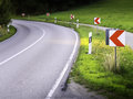 Dangerous road curve with warning signs Stock Photography
