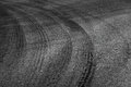 Dangerous turn abstract road background with tires tracks on dark asphalt Royalty Free Stock Images