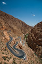 Dangerous turn on the highway pass in moroccan high atlas mountain hot summer day winding road in river valley Royalty Free Stock Image