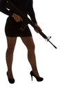 Dangerous woman in black with assault rifle and stylish silhouette Royalty Free Stock Photography